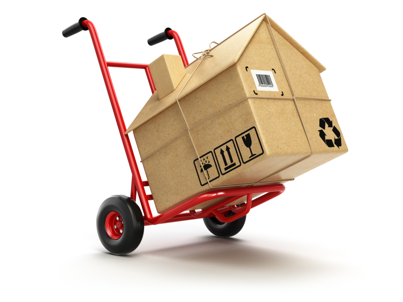 House-shaped box on moving trolley