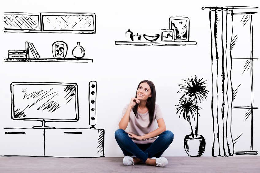 Cheerful young woman smiling while sitting on the floor against white background with drawn home interior